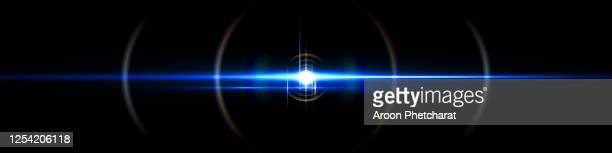 lens flare light on black background - lens flare stock pictures, royalty-free photos & images