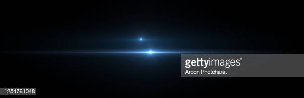 lens flare light on black background. - riflesso foto e immagini stock