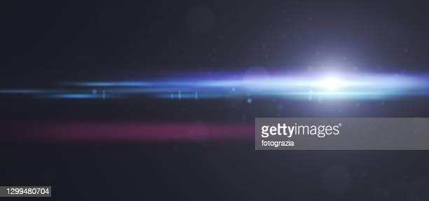 lens flare light on dark panoramic background - glamour stock-fotos und bilder
