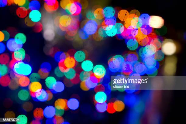 Lens Flare of Christmas lights of a residential building