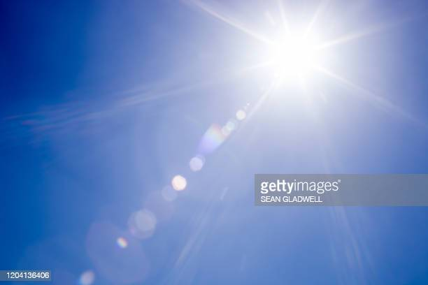lens flare sunlight - lens flare stock pictures, royalty-free photos & images