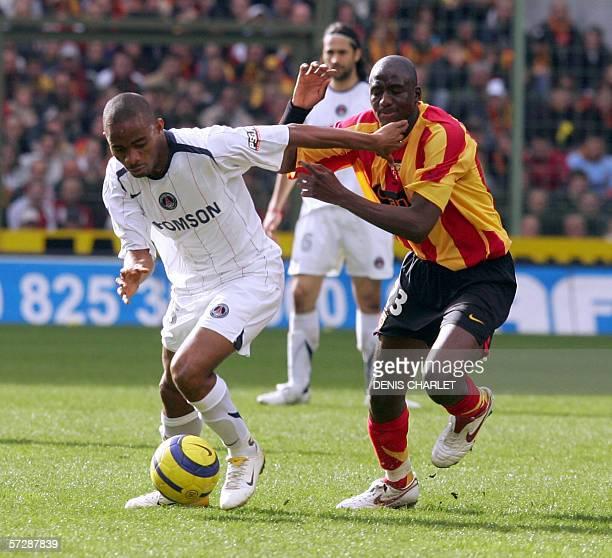 Lens' French midfielder Alou Diara vies with Paris-Saint-Germain's Ivorian forward Bonaventure Kalou during their french L1 football match, 08 April...