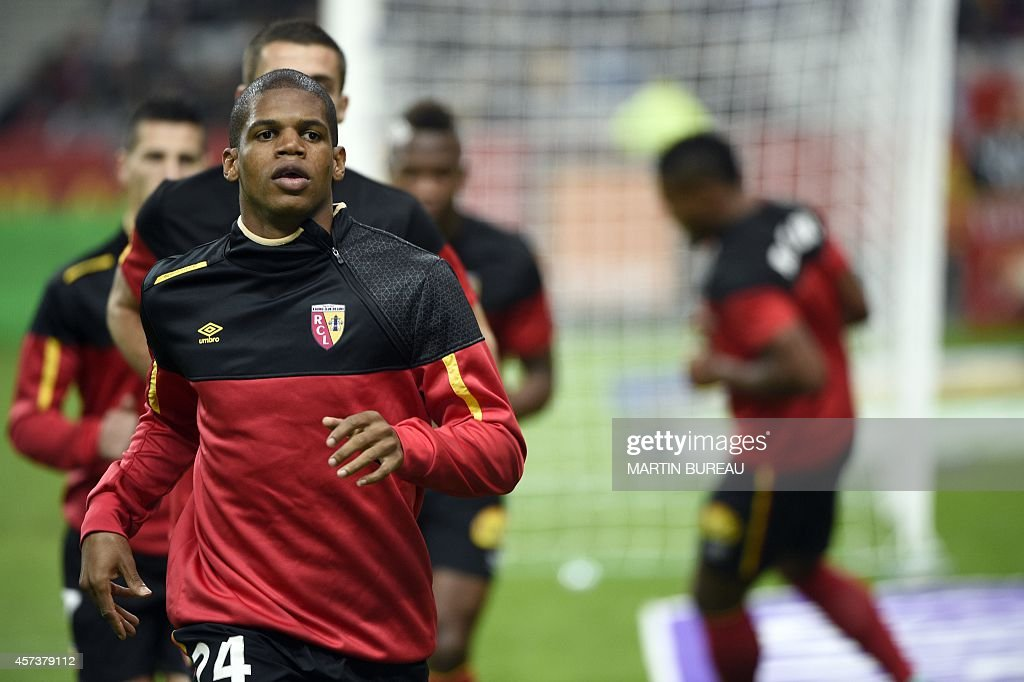 Lens' French defender Ludovic Baal warms up prior to the French L1 football match between Paris Saint-Germain (PSG) and Lens (RCL) on October 17, 2014 at the Stade de France in Saint-Denis, north of Paris.