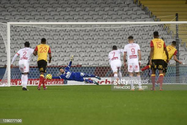 Lens' French forward Florian Sotoca shoots a penalty kick to score during the French L1 football match between RC Lens and Stade Brestois at The...