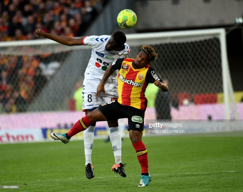 Lens' midfielder Abdellah Zoubir (R) vies with Strasbourg's midfielder Jean-Eudes Aholou during the French L2 football match between Lens and Strasbourg on May 8, 2017 at the Bollaert-Delelis stadium in Lens. /