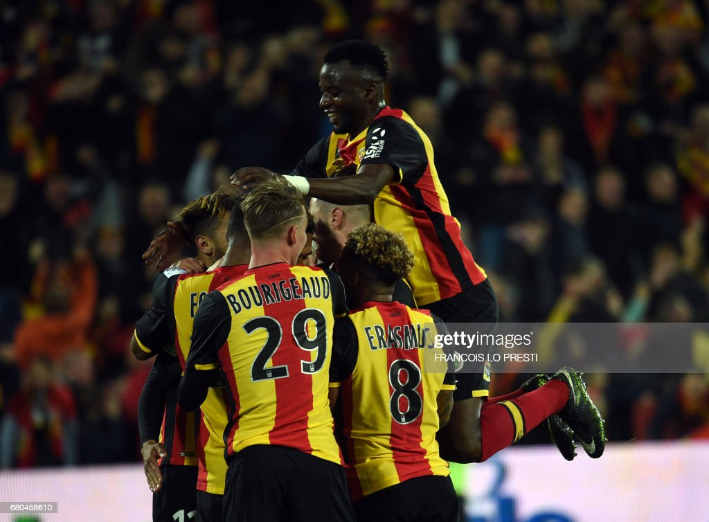 Lens' midfielder Kenny Lala celebrates with his teammates after scoring during the French L2 football match between Lens and Strasbourg on May 8, 2017 at the Bollaert-Delelis stadium in Lens. /