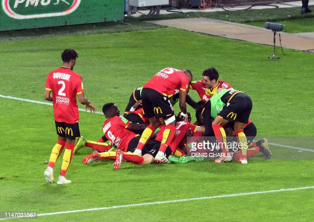 Lens' players celebrate after scoring a goal during the French L1L2 first leg playoff football match between Lens and Dijon at the BollaertDelelis...
