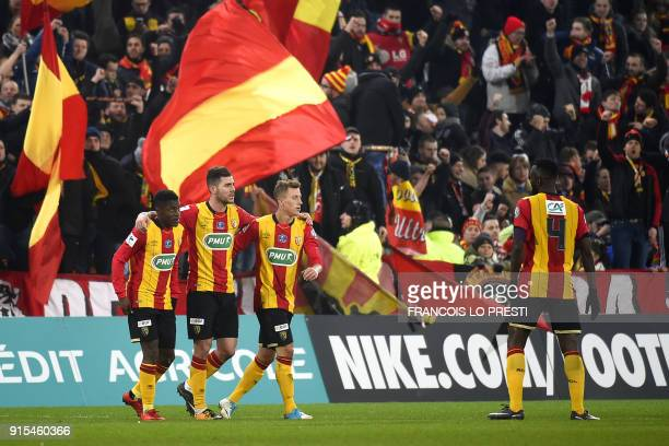 Lens' players celebrate after winning the French Cup round of 16 football match between Lens and Troyes on February 7 the at Bollaert stadium in Lens...