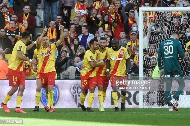 Lens' Polish midfielder Przemyslaw Frankowski celebrates with teammates after scoring a goal during the French L1 football match between RC Lens and...