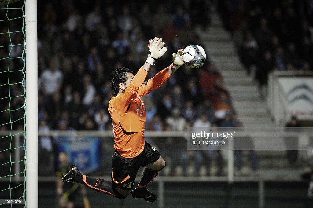 Lens' Tunisian goalkeeper Hamdi Kasraoui stops the ball during the French L1 football match Auxerre vs. Lens on May 8, 2010 at the Abbe-Deschamps stadium in Auxerre, eastern France.
