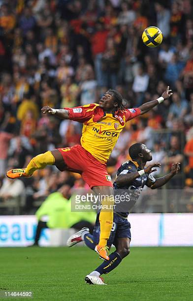 Lens's French defender Serge Aurier vies with ArlesAvignon's French forward Franck Djadjedje during the French L1 football match Lens vs Arles...