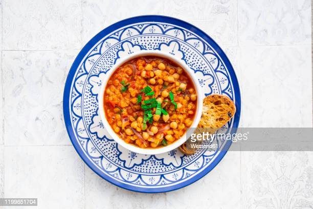 lentil and chickpea soup (red lentils, chickpeas, tomatoes, red onions, mint) - lentil stock pictures, royalty-free photos & images