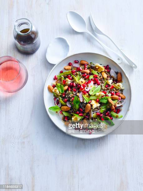 lentil and tricolour quinoa salad with cinnamon dressing - lentil stock pictures, royalty-free photos & images