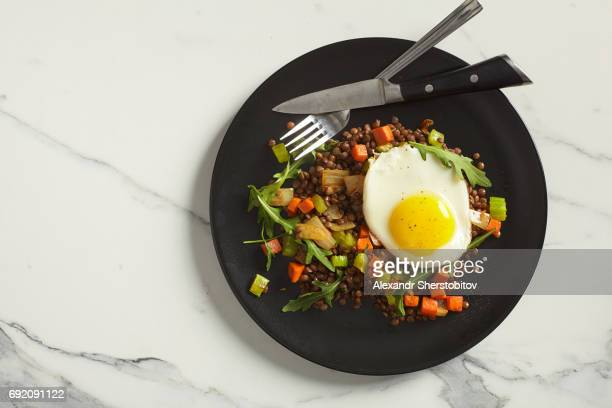 Lentil with vegetables and fried egg