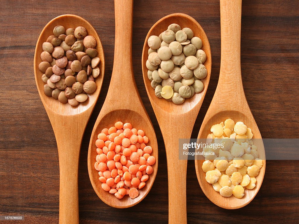 Lentils and spoons : Stock Photo