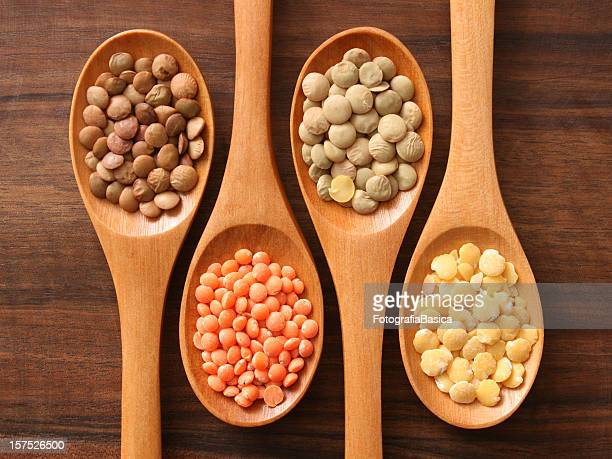 lentils and spoons - lentil stock pictures, royalty-free photos & images
