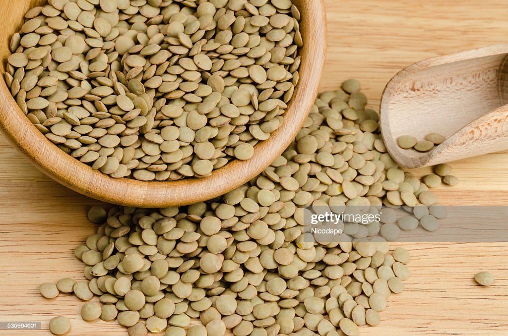 lentils, on wood, background, close up : Stock Photo