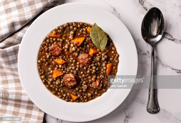 lentils soup with chorizo - chorizo stock pictures, royalty-free photos & images