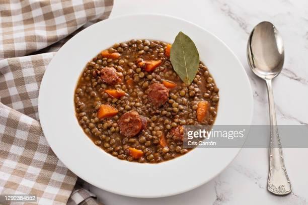 lentils soup with chorizo - cris cantón photography fotografías e imágenes de stock