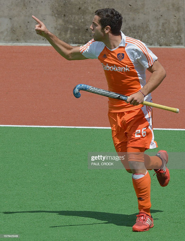 lentin Verga of The Netherlands celebrates his goal against Pakistan during their semi final match at the Men's Hockey Champions Trophy in Melbourne on December 8, 2012. IMAGE STRICTLY RESTRICTED TO EDITORIAL USE - STRICTLY NO COMMERCIAL USE AFP PHOTO/Paul CROCK