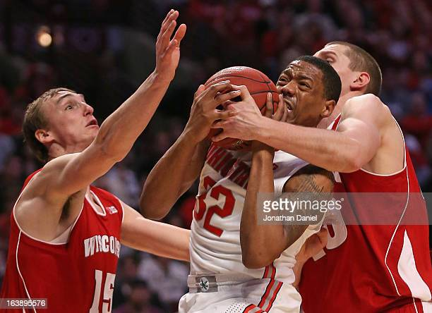 Lenzelle Smith Jr #32 of the Ohio State Buckeyes receieves pressure from Sam Dekker and Jared Berggren of the Wisconsin Badgers during the Big Ten...