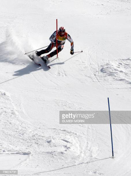 Lenzerheide, SWITZERLAND: Norway's Aksel Lund Svindal, winner of the World Cup overall title, competes during the men's slalom second run at the...