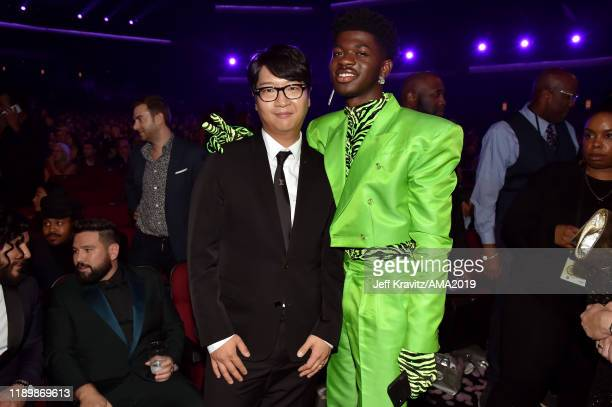 Lenzo Yoon CoCEO of Big Hit Entertainment and Lil Nas X during the 2019 American Music Awards at Microsoft Theater on November 24 2019 in Los Angeles...