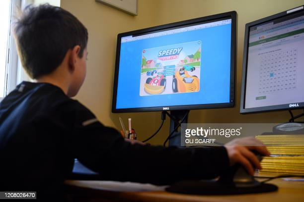 Leo, aged 6, navigates online learning resources provided by his infant school in the village of Marsden, near Huddersfield, northern England on...