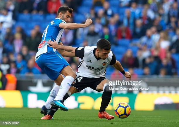 Leo Baptistao of Espanyol competes for the ball with Jose Luis Gaya of Valencia during the La Liga match between Espanyol and Valencia at CornellaEl...