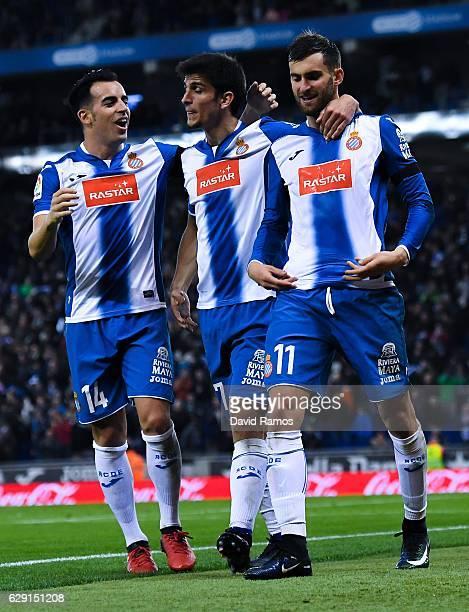 Leo Baptistao of RCD Espanyol celebrates with his team mates Gerard Moreno and Jose Manuel Jurado after scoring his team's second goal during the La...