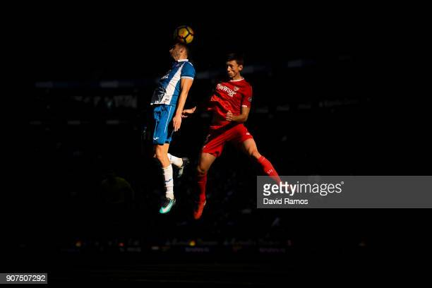 Leo Baptistao of RCD Espanyol competes for a high ball with Clement Lenglet of Sevilla FC during the La Liga match between Espanyol and Sevilla at...