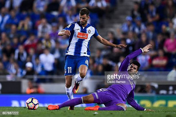 Leo Baptistao of RCD Espanyol competes for the ball with Alvaro Morata of Real Madrid CF during the La Liga match between RCD Espanyol and Real...