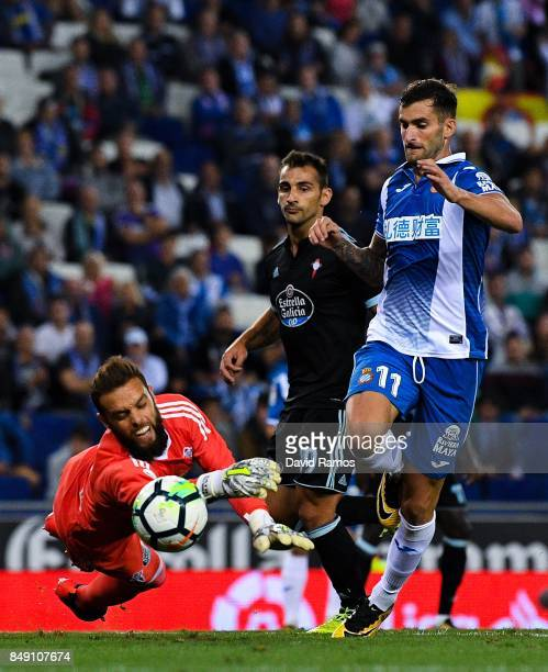 Leo Baptistao of RCD Espanyol competes for the ball with Sergio Alvarez of RC Celta de Vigo during the La Liga match between Espanyol and Celta de...