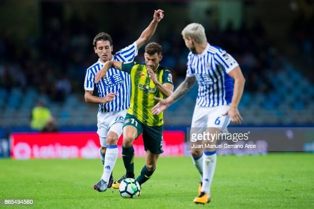 Leo Baptistao of RCD Espanyol duels for the ball with Mikel Oyarzabal of Real Sociedad during the La Liga match between Real Sociedad de Futbol and...