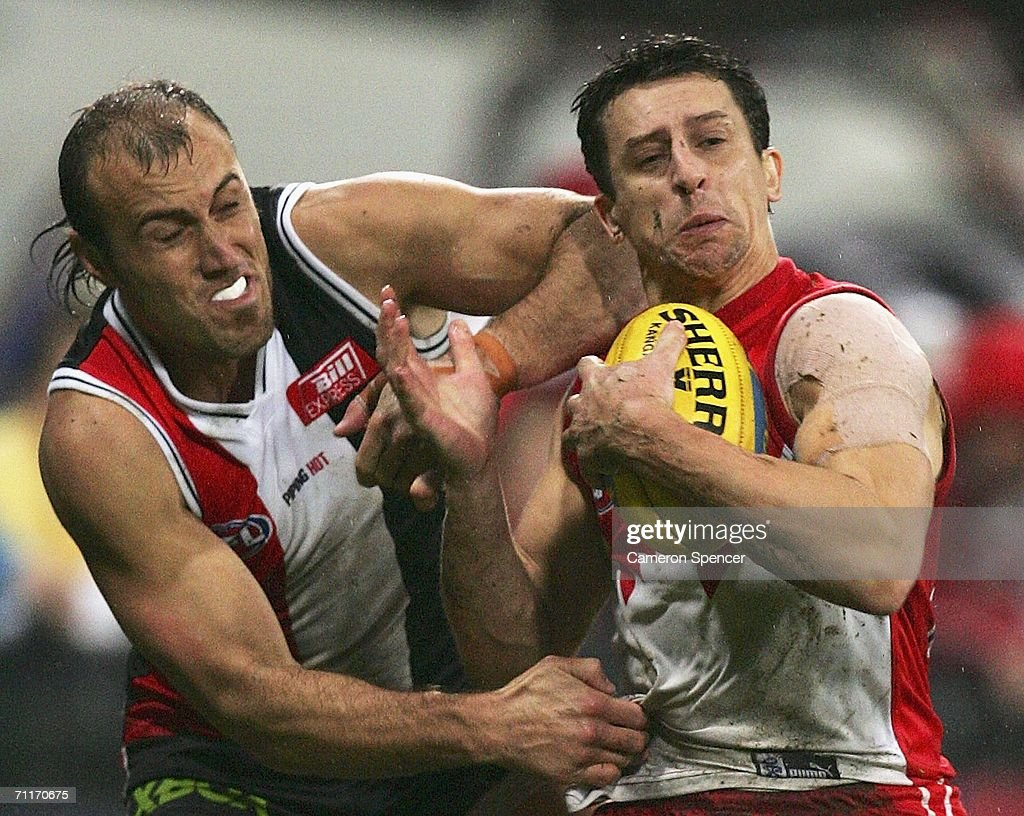 Leo Barry of the Swans is tackled by Fraser Gehrig of the Saints during the round 11 AFL match between the Sydney Swans and the St Kilda Saints at the Sydney Cricket Ground June 10, 2006 in Sydney, Australia.