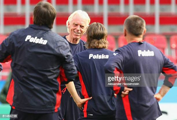 Leo Beenhakker , head coach of the Polish team, talks to his players during the training session of the Polish national team at the Woerthersee...