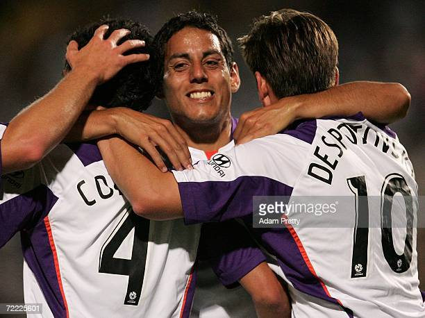 Leo Bertos embraces his Glory team mates Simon Colosimo and Bobby Despotovski after a goal during the round nine Hyundai ALeague match between the...