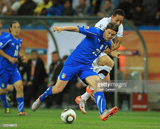 Leo Bertos of New Zealand challenges Riccardo Montolivo of Italy during the 2010 FIFA World Cup South Africa Group F match between Italy and New...