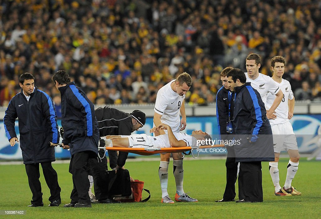 Leo Bertos of New Zealand is carried off the pitch after a clash with Tim Cahill of Australia during their friendly international football match in Melbourne on May 24, 2010. Australia won the match 2-1. RESTRICTED