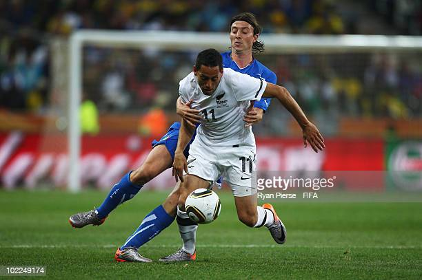 Leo Bertos of New Zealand is challenged by Riccardo Montolivo of Italy during the 2010 FIFA World Cup South Africa Group F match between Italy and...