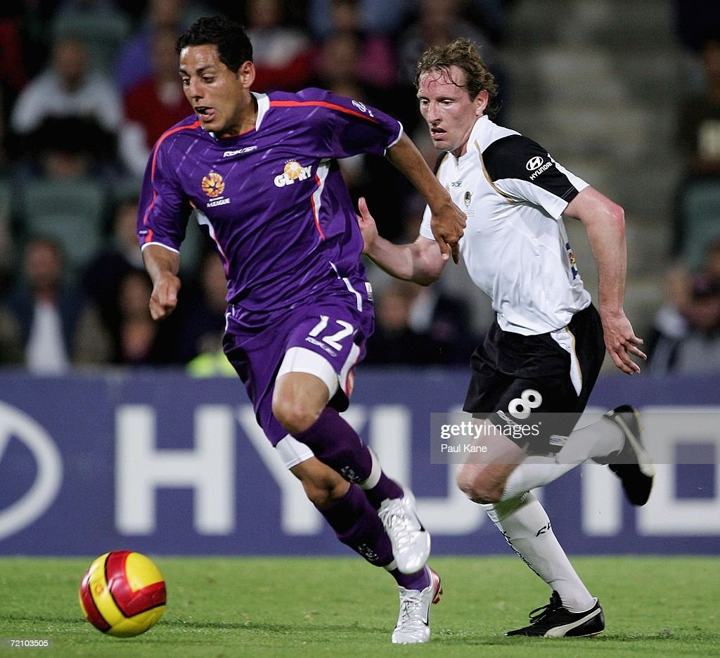 Leo Bertos of the Glory breaks away from Scott Gemmill of the Knights during the round seven Hyundai A-League match between Perth Glory and the New Zealand Knights at Members Equity Stadium October 6, 2006 in Perth, Australia.