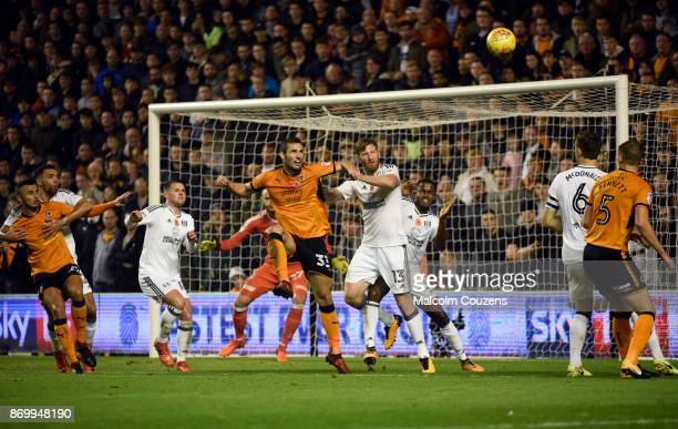 Leo Bonatini of Wolverhampton Wanderers and Tim Ream of Fulhan compete during the Sky Bet Championship match between Wolverhampton Wanderers and...