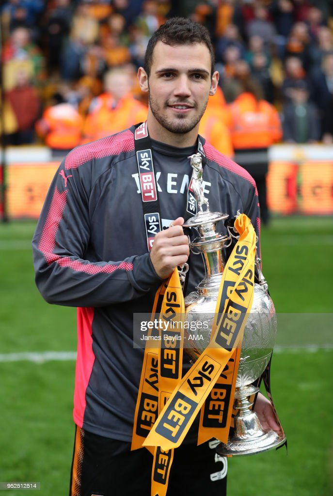 Leo Bonatini of Wolverhampton Wanderers celebrates with the EFL Sky Bet Championship trophy after the Sky Bet Championship match between Wolverhampton Wanderers and Sheffield Wednesday at Molineux on April 28, 2018 in Wolverhampton, England.