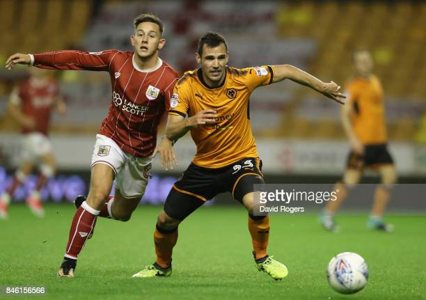 Leo Bonatini of Wolverhampton Wanderers is challenged by Josh Brownhill during the Sky Bet Championship match between Wolverhampton and Bristol City...