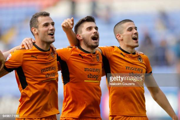 Leo Bonatini Ruben Neves and Conor Coady of Wolverhampton Wanderers celebrate following the Sky Bet Championship match between Bolton Wanderers and...