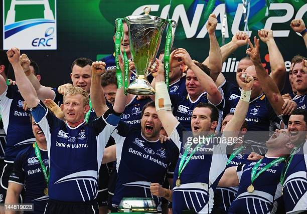 Leo Cullen and Shane Jennings lift the trophy in celebration with Leinster team mates following their victory during the Heineken Cup Final between...