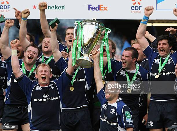 Leo Cullen captain of Leinster raises the Heineken Cup with team mate Chris Whitaker after winning the Heineken Cup Final between Leicester Tigers...