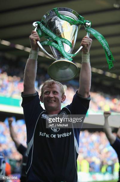 Leo Cullen of Leinster lifts the trophy following his team's victory at the end of the Heineken Cup Final match between Leicester Tigers and Leinster...