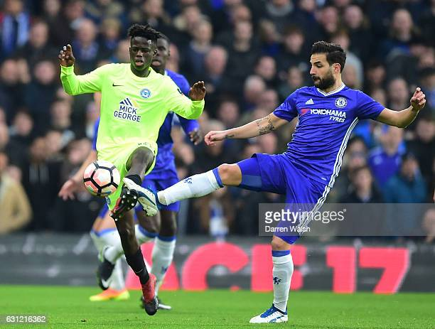 Leo Da-Silva-Lopes of Peterborough United and Cesc Fabregas of Chelsea battle for possession during The Emirates FA Cup Third Round match between...