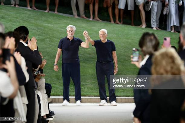Leo Dell'Orco and Fashion Designer Giorgio Armani acknowledge the applause of the audience during the Giorgio Armani Fashion Show at the Milan Men's...
